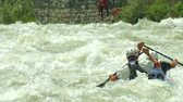 river : Two athletes participates in the ICF Wildwater Canoeing World Championships, 11 June 2014 on River Adda in Valtellina (Italy)