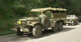 csatatér : US military vehicles column during a WWII reenactment on 20 September 2014 in San Quirico, Italy