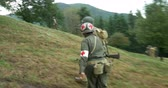 csatatér : US soldiers patrol during a WWII reenactment on 20 September 2014 at Monte Altuzzo, Italy