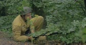 csatatér : German soldier blends for an ambush during a WWII reenactment on 20 September 2014 at Monte Altuzzo, Italy