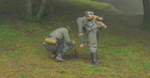 line : German soldiers bury mines during a WWII reenactment on 20 September 2014 at Monte Altuzzo, Italy Stock Footage