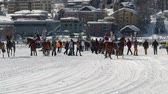 trotting : horses and riders in slow motion before White Turf Grand Prix on February 23rd, 2014 in St. Moritz Switzerland