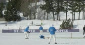 batedor : A cricket bowler throws a ball in a cricket match during Cricket on Ice in St. Moritz (Switzerland) on 18th February 2016