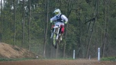 terreno extremo : A motocross rider jumps in slow-motion