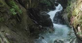 tirol : A small creek flows among rocks in the mountain