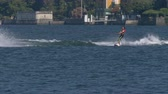 "movimento : A boy jumps the wake behind a motorboat during the ""Wake Zone Cup� on 1 July 2108 in Lake Como (Italy)"