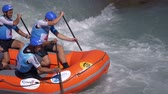 exciting : The Czech Republic men's Under 19 rafting team in the training (in slow motion) on the Dora Baltea river during World Rafting Championship on 23 July 2018, Ivrea (Italy) Stock Footage