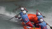 болгарский : The Bulgarian Under 23 men's rafting team in the training on the Dora Baltea river during World Rafting Championship on 23 July 2018, Ivrea (Italy) Стоковые видеозаписи