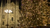 Christmas tree lights decorations and Duomo cathedral at night, December 2017, Milan (Italy)