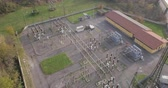 transformatör : Aerial view of a high voltage power substation on an autumn morning.