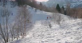 Kids playing with bobs on a snowy mountain in Italian Alps.