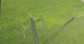 haute tension : High voltage tower from above, green meadow background