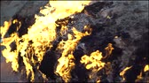Natural burning ground. Burning natural gas from underground.