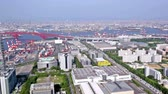 doca : Aerial panoramic view of industrial Osaka bay and city skyline of Osaka, Japan