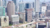 kansai : timelapse of aerial view of Umeda District of Kita, view from Umeda Sky Building, Osaka, Japan, UHD
