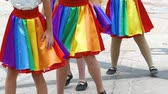 dobras : A team of young girls is dancing. Girls dance in the same rainbow suits. Rainbow skirt. Stock Footage