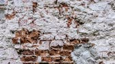 gesso : Brick wall with crumbling plaster on old building.