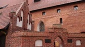 knight : The Castle of the Teutonic Order in Malbork is the largest castle in the world by surface area. It was built in Marienburg, Prussia by the Teutonic Knights, in a form of an Ordensburg fortress.