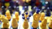 checkmate : Multicolored carved wooden chess close-up. Stock Footage