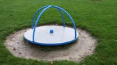 çok renkli : Childrens metal centrifuge is located on playground. Stok Video