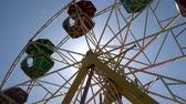 a view : The Ferris wheel in the center of the park Stock Footage