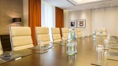 corporate : Meeting room. Long table with leather armchairs in empty room for business meetings in premium business center