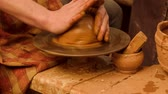 crock : How do you make this crock. Potter working making kind of crockery teacher helping him, creation process