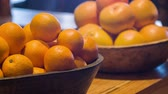 crock : Fresh ripe oranges. Selective focus on fresh good-looking oranges lying in nice little crocks