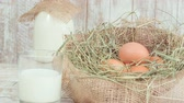 condensed : Milk and eggs in straw nest. Stock Footage