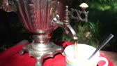 cobre : Pouring Tea From Russian Kettle samovar Outdoors