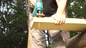зажимное приспособление : Man sawing a wooden board with a jigsaw 4K