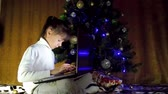 working parents : Child with laptop in the New Year. Stock Footage