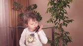 para : A child talking on a cell phone