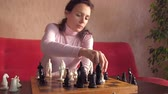 sex : Girl playing chess.