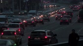 heavy : Heavy traffic on street in the evening. Cars with headlights go along Independence Avenue in Minsk, Belarus. Stock Footage