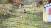 little : little girl running in the nature near the house and car Stock Footage