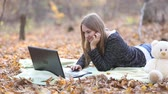 joy : girl with a laptop in the autumn forest Stock Footage