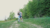 fitness : The couple strolls by the forest