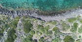 назад : backward overhead aerial on mediterranean sea wild coast, blue water.Nature environment outdoors travel establisher,Italy,Sicily Salina Eolian Island.Sunny summer.4k drone top view establishing video Стоковые видеозаписи