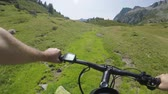 POV man riding e-bike on hill.Mtb action cyclist exploring trail path near mountains.Electrical bike active people sport travel vacation in Europe Italy Alps outdoors in summer.4k video Stok Video