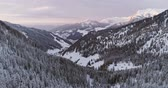 sella : Forward aerial to snowy valley with woods forest at Sella pass.Sunset or sunrise,cloudy sky.Winter Dolomites Italian Alps mountains outdoor nature establisher.4k drone flight Stock Footage