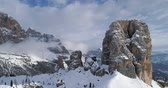 dolomites : Backward aerial through majestic Cinque Torri rocky mounts. Sunny day with cloudy sky.Winter Dolomites Italian Alps mountains outdoor nature establisher.4k drone flight Stock Footage