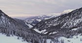 alto : Forward aerial to snowy valley with woods forest at Sella pass.Sunset or sunrise,cloudy sky.Winter Dolomites Italian Alps mountains outdoor nature establisher.4k drone flight Stock Footage