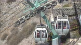 declive : THIRA, GREECE - APRIL 25, 2018: Santorini cable car - moving down cabins