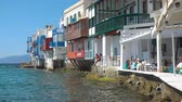 MYKONOS, GREECE - APRIL 22, 2018: Picturesque houses with cafes and bars of Little Venice district in Mykonos Island, Cyclades, Greece Dostupné videozáznamy