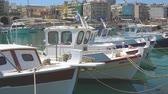 Крит : HERAKLION, GREECE - APRIL 27, 2018: Moored fishing boats in old port of Heraklion, Crete Island, Greece