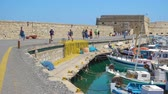 bástya : HERAKLION, GREECE - APRIL 27, 2018: Venetian Fortress in Heraklion and walking people, Crete, Greece