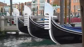 Rostrums of moored gondolas on The Grand Canal in Venice, Italy