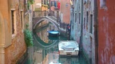 benátky : Perspective of canal with bridge and moored boats in Venice, Italy Dostupné videozáznamy