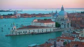 The Grand Canal and Santa Maria della Salute church in Venice in the early evening - panoramic view from above, Italy